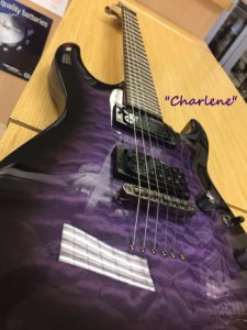 PURPLE GUITAR NAMED CHARLENE